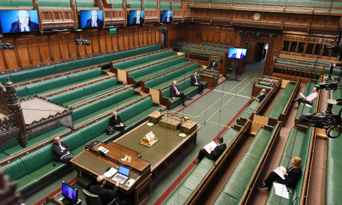 Members of Parliament sitting far apart from one another.
